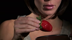 Strawberry dipped into chocolate and eaten. Stock Footage