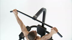Royalty Free Stock Footage of Jib shot of a man doing pull-ups on a white - stock footage