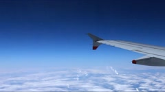 Looking through window aircraft during flight in wing with a nice blue sky Stock Footage