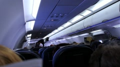 Modern interior of aircraft. Unidentified passengers on seats inside airplane. - stock footage