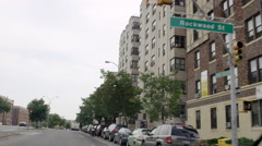 Stock Video Footage of driving down Grand Concourse in the Bronx with trees and buildings, 4K, NYC