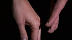 Close up of hands moving slowly to hold each other. Stock Footage