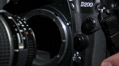Extreme close up of a lens being attached to a camera. Stock Footage