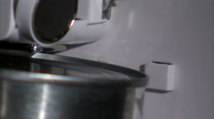 Extreme close up on black of electric can opener opening a can. Stock Footage
