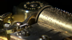 Close up of music box gears turning. Stock Footage