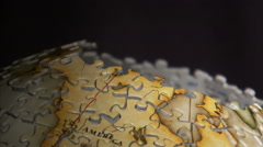 Close up of piece added to 3D globe puzzle. Stock Footage