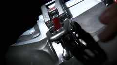 Close up of ski boot buckle being latched. Stock Footage
