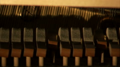 Shot of piano hammers striking a piano's strings. Stock Footage