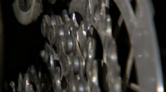 Close up of a chain shifting over rotating bike gears. Stock Footage