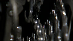Close up of a bike chain shifting over rotating gears. Stock Footage