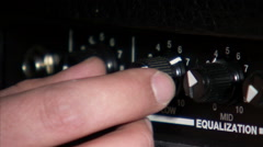 Close up of hands turning guitar amp knobs. Stock Footage