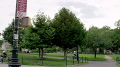 Driving by Joyce Kilmer Park benches and people sitting relaxing Bronx 4K NYC Stock Footage