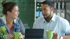 Couple in a cafe using an ipad - stock footage