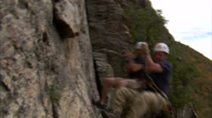 Stock Video Footage of Clip of two rock climbers swinging over the camera.