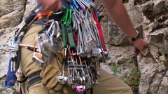 Climber taking a cam from his harness and placing it in a crack. Stock Footage