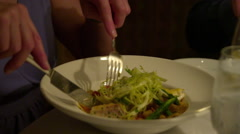 Left to right panning of hands at a table place setting Stock Footage