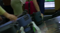 Racking focus shot of luggage on a baggage carousel Stock Footage
