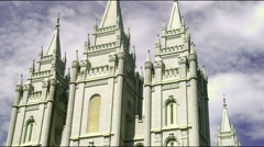 Angled tilt up the face of Mormon temple Stock Footage