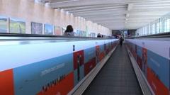 Unidentified passengers at horizontal escalator at Ben Gurion Airport Stock Footage