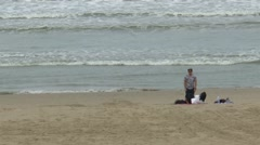 People are playing on the beach Stock Footage