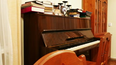Brown Polished Piano in the Library, Shot with Slider Stock Footage