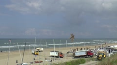 Trucks remove beach houses Stock Footage