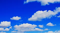 Billowing clouds in a deep blue sky. Stock Footage