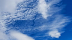 White clouds roll across a blue sky. Stock Footage