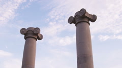 Low-angle slow pan of ionic columns Stock Footage
