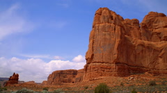 Time-lapse of a red rock cliff and the blue sky and clouds. Stock Footage