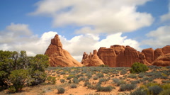 Time-lapse of clouds moving over a desert landscape. Stock Footage