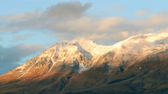 Time-lapse of the snow-capped Wasatch Mountains at dusk. Stock Footage