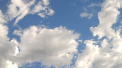 Time-lapse of fluffy clouds in a bright blue sky. Stock Footage