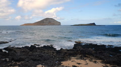 Time-lapse of the beach with Rabbit Island in the background in Hawaii. Stock Footage