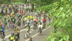 Mass of cyclists in central park Stock Footage