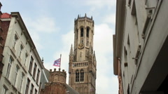 Time-lapse of clouds over a clock tower in Bruges, Belgium. - stock footage