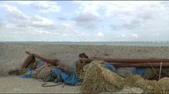 Fishing nets on the quay, at the horizon the Eeland bridge - stock footage