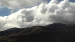 Slow motion shot of clouds over hills in Utah Stock Footage
