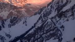 Panning aerial shot of snow-capped mountain peaks in Utah Stock Footage