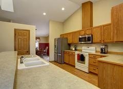 Traditional style kitchen with dish washer. - stock photo