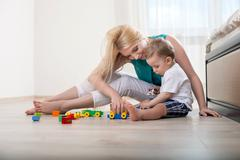 Beautiful young mother with her little child Stock Photos