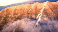 Aerial shot of snow-capped mountains in Utah Stock Footage