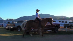 Lens flare shot of a rodeo rider on his horse in Utah Stock Footage