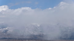Panning time-lapse shot of snowstorm in the mountains at Utah - stock footage