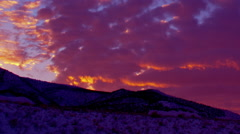 Time-lapse panning shot of mountain and clouds in Utah at sunset Arkistovideo