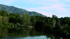 Trees along a lake in Utah zoom Stock Footage