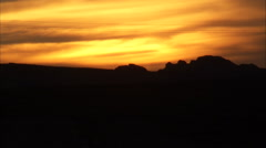 Golden sky over mountains just after sunset. Stock Footage