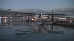 Plane in the bay at Vancouver with Olympic rings in the background. Stock Footage