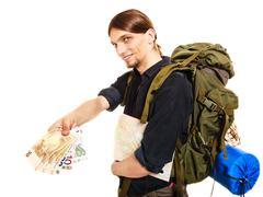 Man tourist backpacker paying euro money. Travel. Stock Photos