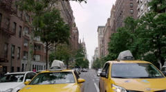 Taxi cabs lined up at crosswalk on 5th Ave Empire State Building Manhattan NYC Stock Footage